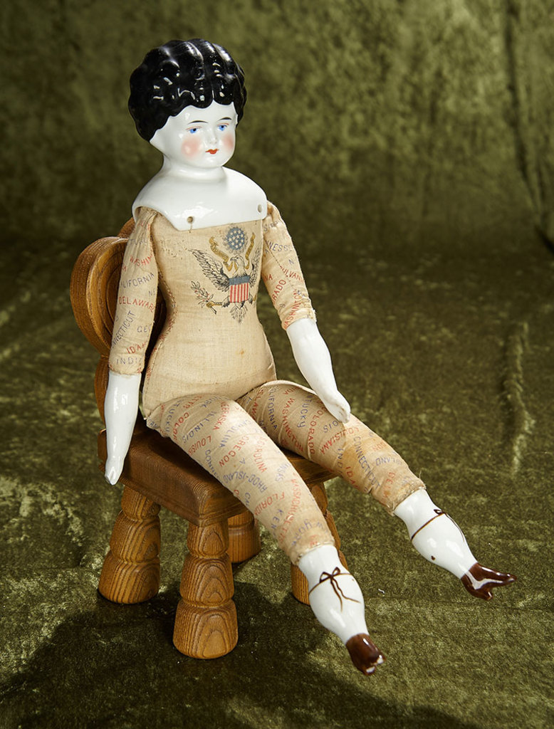 """17"""" German porcelain doll with rare American States lithographed body. $300/500"""