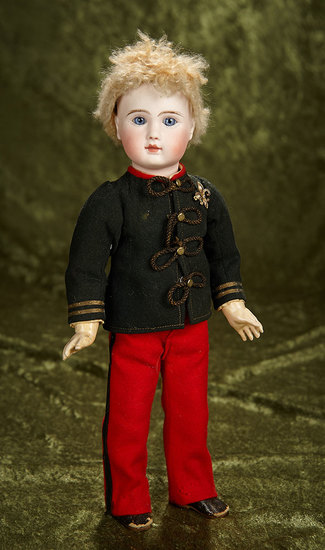 """15"""" French bisque bebe, Figure A, by Jules Steiner in original military costume. $1800/2300"""