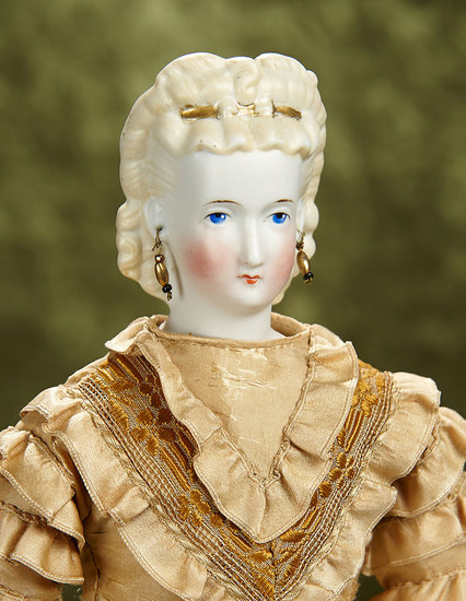 """17"""" German bisque lady doll with blonde sculpted hair with gilt hair comb. $500/700"""