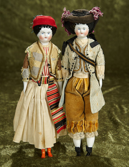 """Pair, 11"""" German porcelain dolls with original traditional costumes. $400/600"""