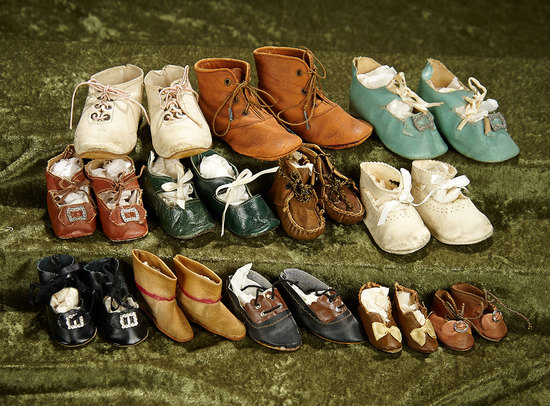 Twelve pairs of antique doll shoes. $200/300