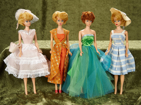 "Four 11"" Bubble Cut Barbies by Mattel in early costumes. $400/600"