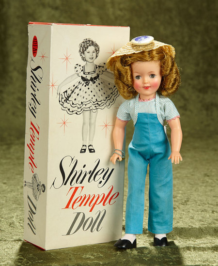 "12"" Vinyl Shirley Temple Doll by Ideal with original costume and original box. $200/300"