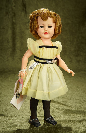 "18"" Vinyl Shirley Temple in yellow nylon dress, original box, three original paper labels. $300/400"