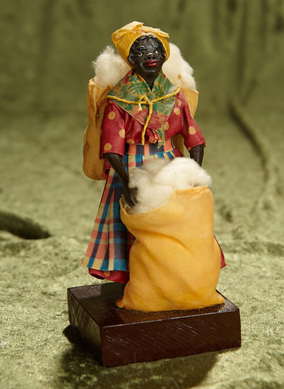 "7"" Wax Doll Depicting Black Woman in Original costume with bags of cotton by Vargas. $300/500"