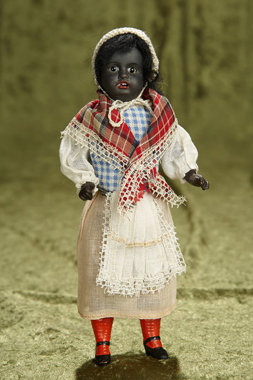 "8"" All-Original German black-complexioned child, 34.16, by Gebruder Kuhnlenz. $400/500"