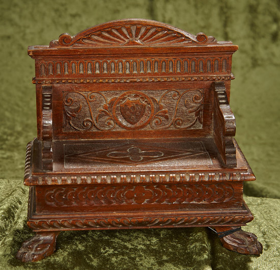 "9""l. French carved wooden blanket bench in the Neo-Gothic style, claw feet. $400/500"