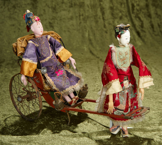 "11"" Two Chinese opera dolls in rare costumes, along with early tin sedan chair. $400/500"