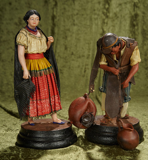 "13"" 19th Century poured wax figures of man and woman, wax-dipped original costumes. $500/700"