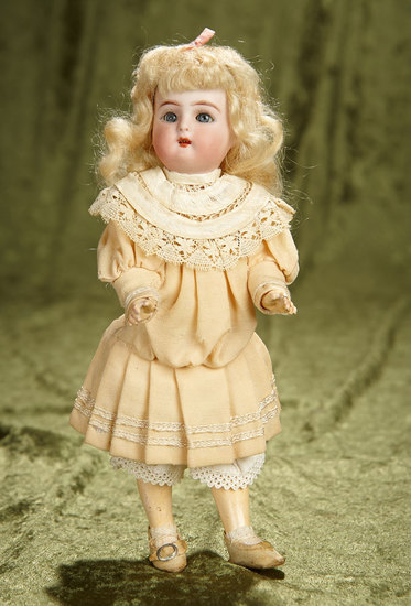 "9"" German bisque miniature doll by K*R in store-original costume. $400/500"