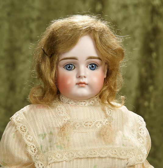 "16"" German bisque closed mouth child, model XI, by Kestner with original early body. $1200/1800"