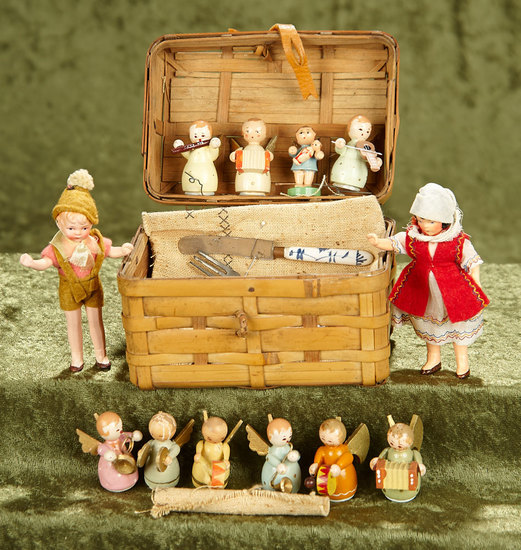 "Two 4"" German painted bisque dollhouse dolls in basket with Erzebirge figures. $200/300"