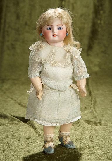 "12"" Petite German Bisque Doll by Simon and Halbig. $900/1300"