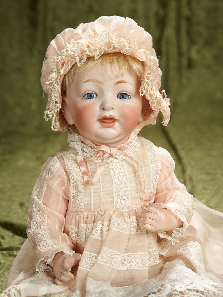 "14"" German bisque character, 211, by Kestner with original body and wig. $400/500"