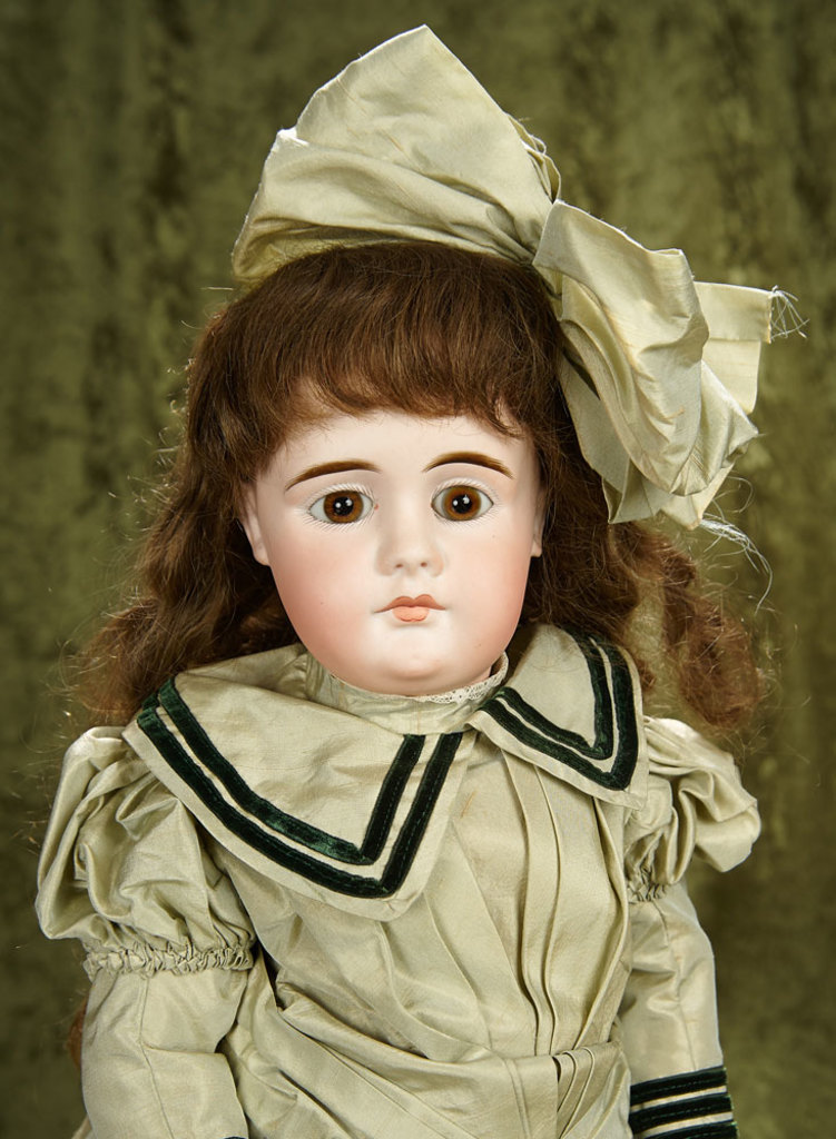 """23"""" Sonneberg bisque closed mouth doll with character like expression, original body. $1100/1300"""