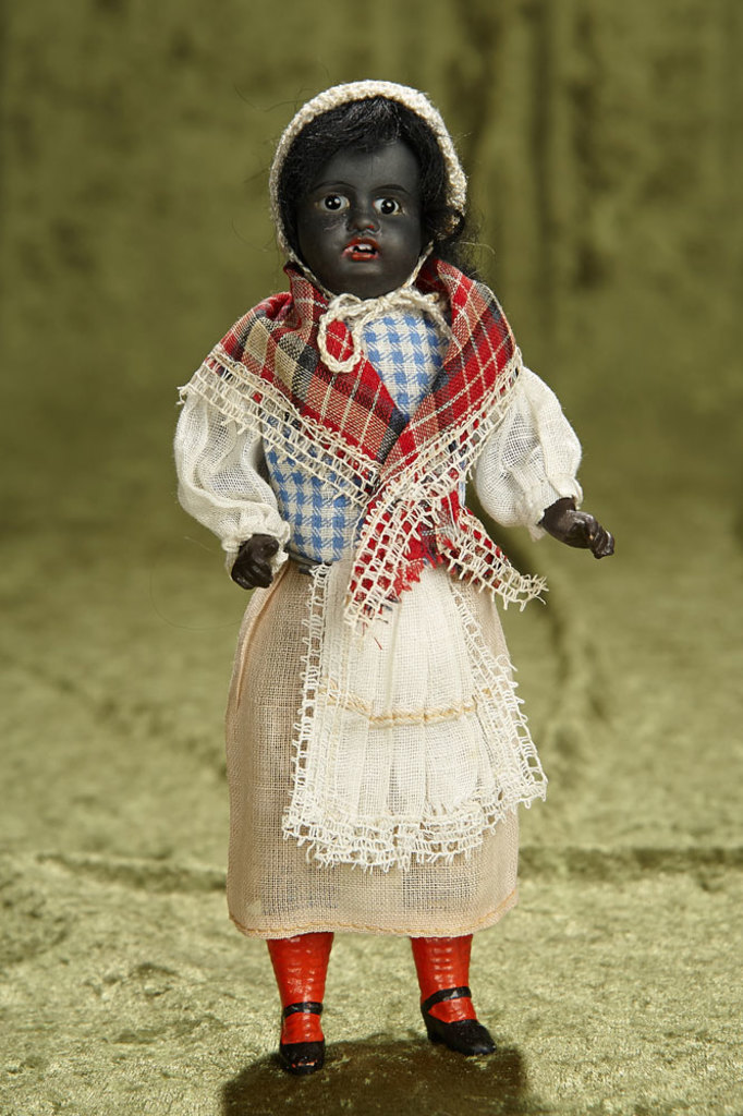 "8"" All-Original German black-complexioned child, 34.16, by Gebruder Kuhnlenz. $400/500"