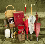Collection of doll accessories including sewing necessaires and parasols. $400/500
