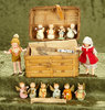 """Two 4"""" German painted bisque dollhouse dolls in basket with Erzebirge figures. $200/300"""