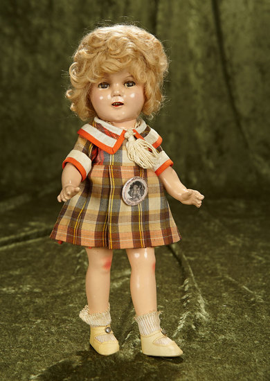 "13"" Composition Flirty-Eyed Shirley Temple by Ideal in brown plaid ""Bright Eyes"" costume. $200/300"