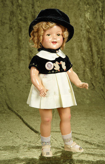 "22"" Composition Shirley Temple by Ideal in NRA-tagged ""Curly Top"" duck costume. $500/700"