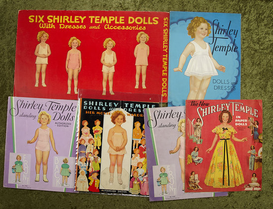 Eight Shirley Temple Paper Doll Books, 1930s. $400/500