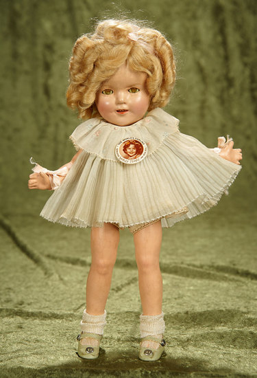 "13"" Composition Shirley Temple in Original NRA-tagged publicity dress. $400/500"
