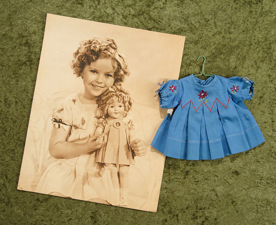 Sepia vintage photograph of Shirley Temple with Doll, With Curly Top Dress. $300/400