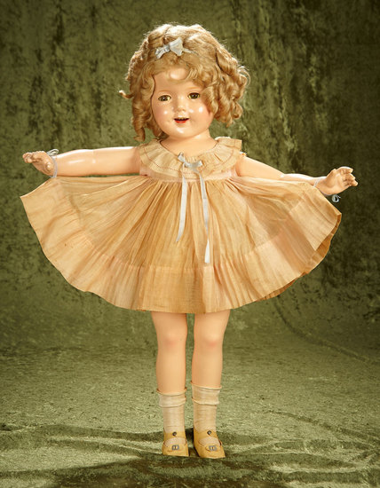 "27"" Composition Shirley Temple by Ideal with flirty eyes and original NRA costume, 1934. $500/800"