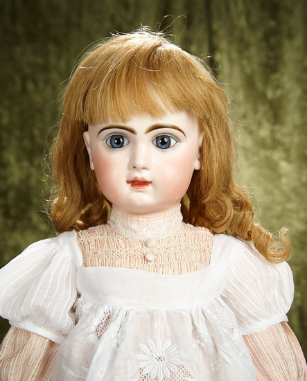 "24"" French bisque Bebe Jumeau, size 11, closed mouth, lovely gleaming complexion. $2400/2800"