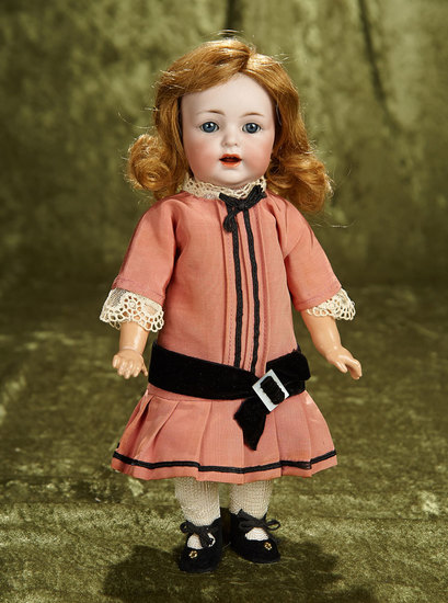 "11"" German bisque toddler, model 122, by Kammer and Reinhardt. $300/500"