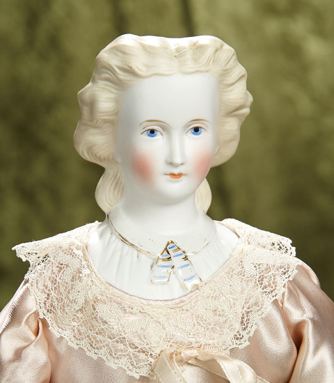 "20"" German bisque lady doll with blonde sculpted hair, snood and fancy bodice. $500/750"