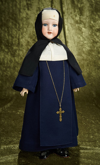 "23"" German bisque child by Marseille in original nun's habit. $300/400"