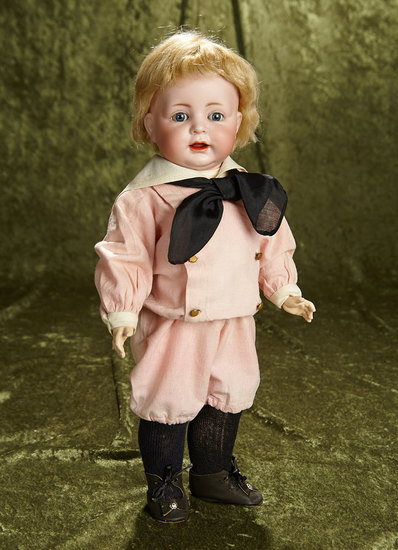 "16"" German bisque character, 116, by Kammer and Reinhardt, toddler body, costume. $1100/1400"