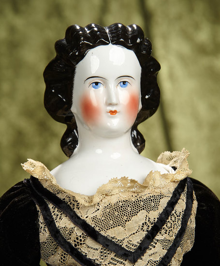 "19"" German porcelain lady doll with black sculpted hair and snood. $400/600"