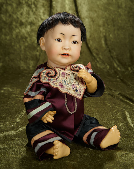 "18"" German bisque portrait of Chinese baby, 243, Kestner in superb antique costume. $2800/3200"