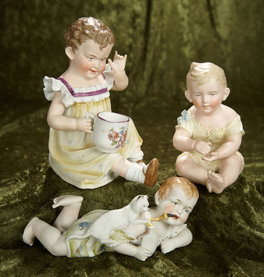 "6""-8"" Three German all-bisque piano babies in playful poses by Hertwig. $500/700"