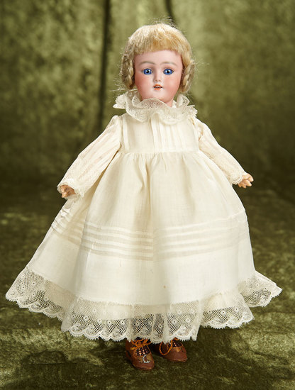 "12"" Very dear petite German bisque child, 1249, by Simon & Halbig in antique costume. $400/600"