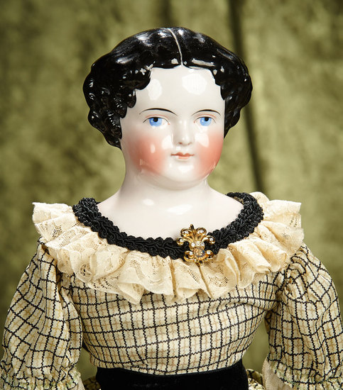 "23"" German porcelain lady doll with pink-tinted complexion. $300/400"