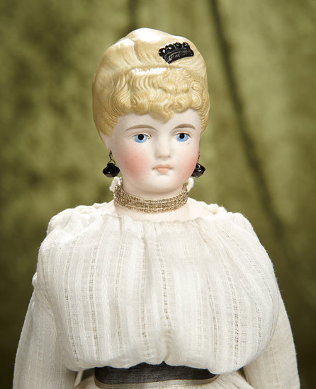 "17"" German bisque lady doll with blonde sculpted hair and sculpted hair comb. $400/500"