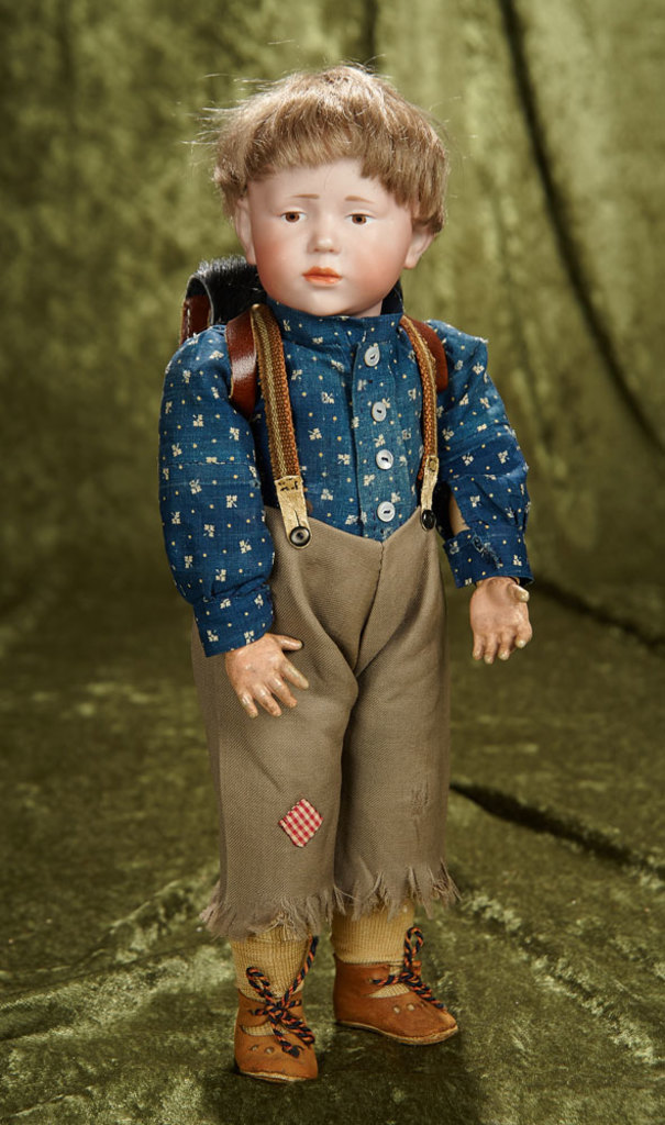 """14"""" German bisque pouty character, """"Peter"""" by Kammer and Reinhardt with costume. $1200/1500"""