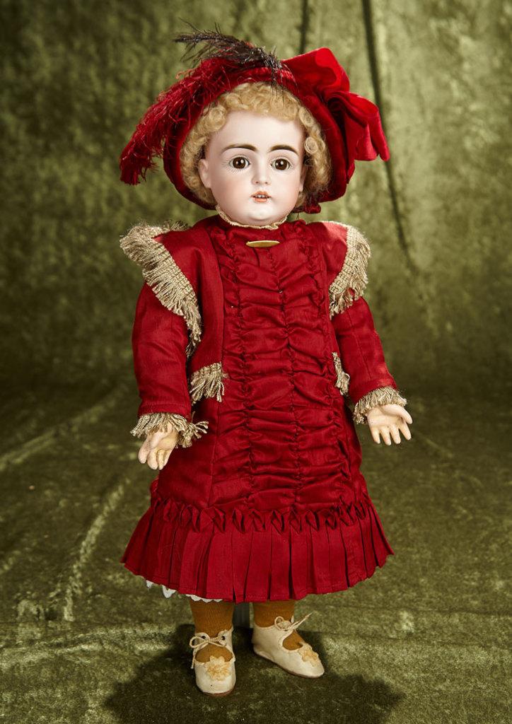 "18"" German bisque child by Kestner in lovely burgundy costume. $400/500"