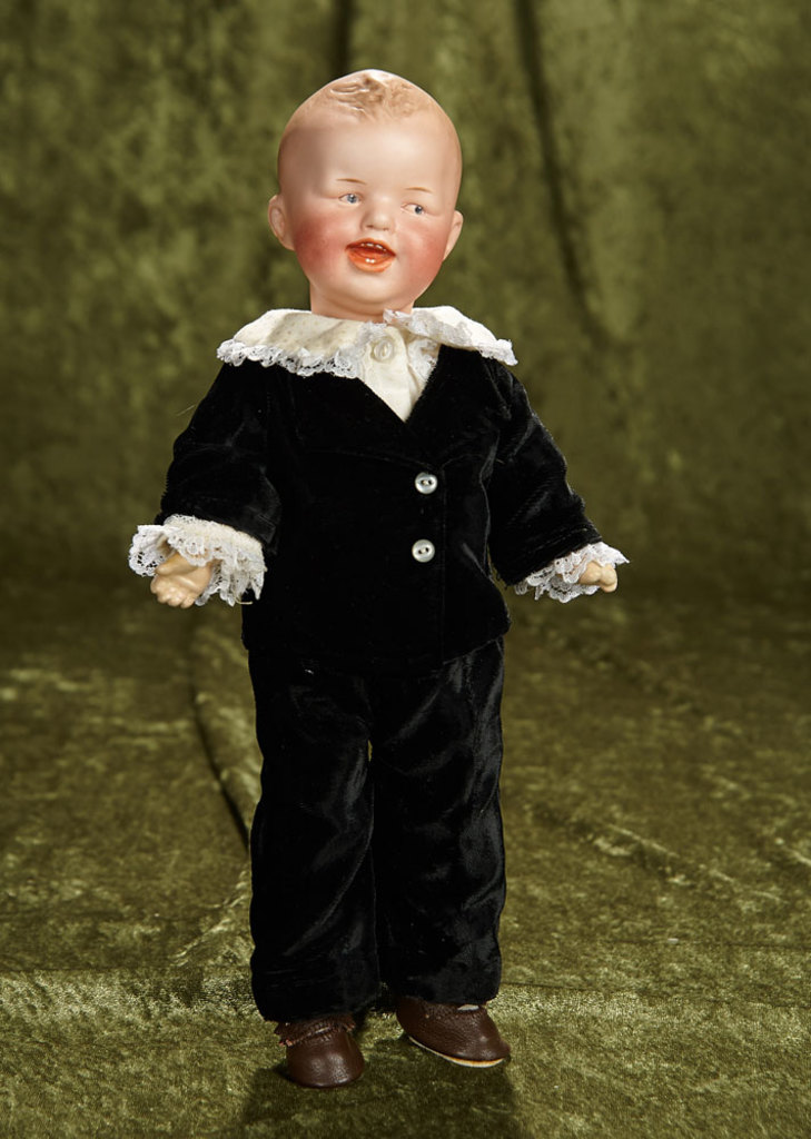 """13"""" German bisque laughing character by Gebruder Heubach. $700/900"""
