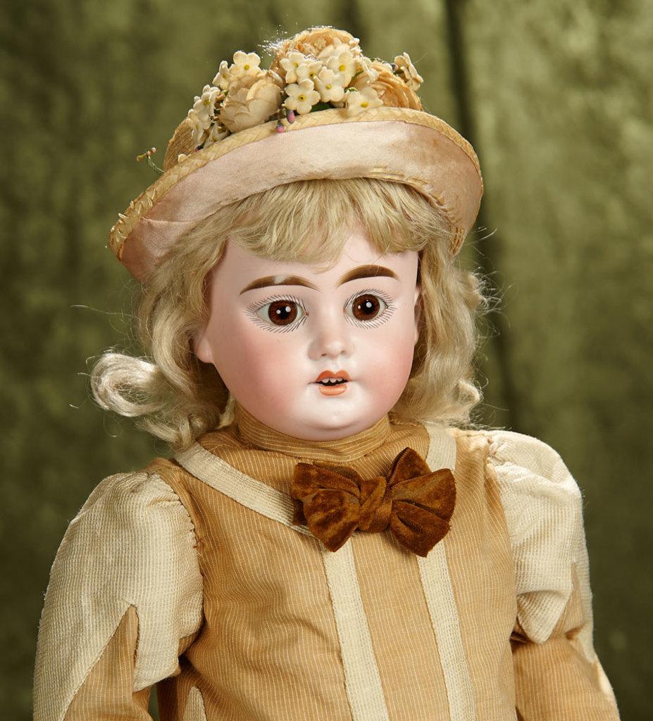 """20"""" German bisque child doll, 1894, by Marseille in wonderful antique costume. $400/500"""