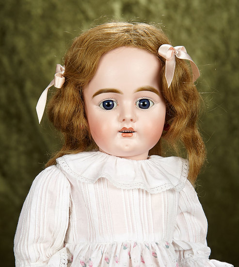 """20"""" German bisque child, 379, by Bahr and Proschild with deep chin dimple. $400/500"""