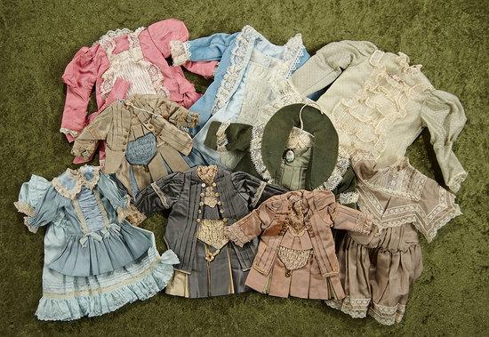 "Ten silk dresses suitable for child dolls 14""-16"". $200/300"
