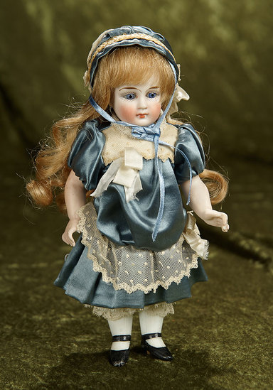 """Large 9"""" German all-bisque miniature doll with pretty costume. $500/700"""