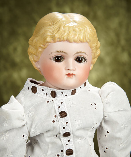 """20"""" German bisque child with blonde sculpted hair and brown glass eyes. $500/750"""