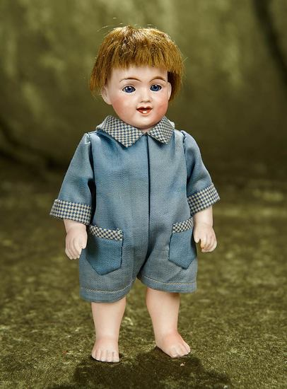 "8"" German all-bisque laughing character, model 369, in antique romper. $400/500"