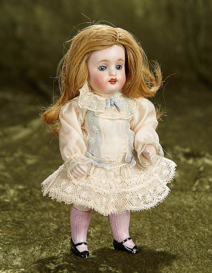 "7"" German all-bisque miniature doll, model 150, by Kestner. $400/500"