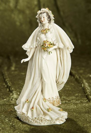 "9"" German porcelain figurine of bride with flowing gown of Dresden lace. $300/400"
